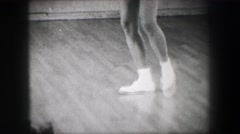 1966: Jazz dance moves 1 closeup behind kick stepping shuffle slide. NEW YORK Stock Footage