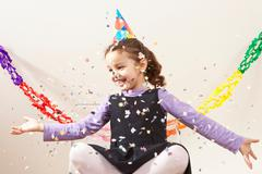 Little girl with confetti - stock photo
