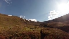 Carpet of Withered Grass on Top of Mountain Under a Bright Sun Panorama From Stock Footage