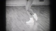 1966: Jazz dance moves 3 closeup behind kick stepping shuffle slide. NEW YORK Stock Footage