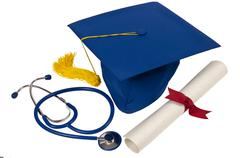 Graduation Hat With Stethoscope and Diploma Kuvituskuvat