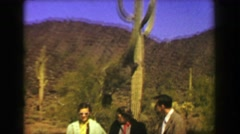 1951: Tall old cactus family grudgingly posing on road trip vacation.   AJO, Stock Footage