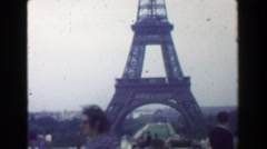 1949: Eiffel Tower view man wanting picture taken at historic monument. PARIS, Stock Footage