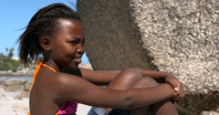 4K Portrait of happy young girl relaxing on beautiful South African beach Stock Footage
