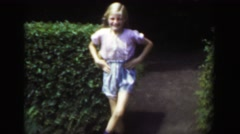 1949: Blond long braided hair light skinned girl dancing jig outdoor shorts. Stock Footage