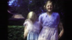 1949: Sisters dancing outdoor garden blond caucasian girls enjoying summer. Stock Footage