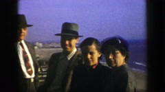 1939: Ocean beach overlook view family formally dressed for the occasion. SAN Stock Footage