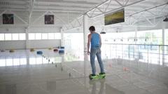 Man acrobat balancing Segway motorized scooter io hawk - shows tricks - stock footage