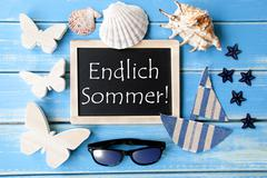 Blackboard With Maritime Decoration, Endlich Sommer Means Happy Summer - stock photo