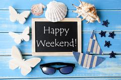 Blackboard With Maritime Decoration And Text Happy Weekend - stock photo