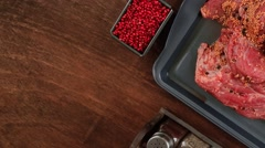 Raw beef fillet chunk on black tray asparagus Stock Footage