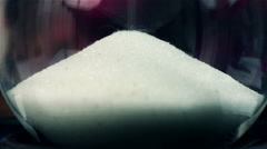 White Sand Flowing Through An Hourglass Stock Footage