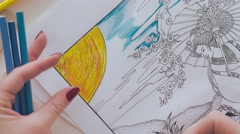 Adult coloring book, female hands coloring drawing - stock footage