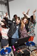 Disc jockeys dancing at party - stock photo