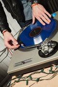 Disc jockey at party on mixing desk Stock Photos