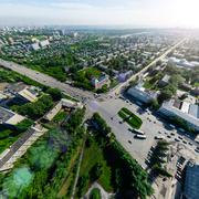 Aerial city view with crossroads and roads, houses buildings. Copter shot Kuvituskuvat