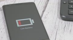 4K Low Smartphone Battery - Dolly Slider Shot Stock Footage