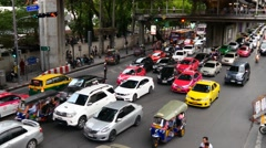 4k busy city traffic intersection commuter rush hour center cars time lapse Stock Footage
