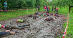 Teams are quickly going across the mud pool Stock Footage