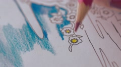Woman coloring drawing, close-up Stock Footage