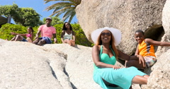 4K Portrait of happy family relaxing together on beautiful South African beach Stock Footage