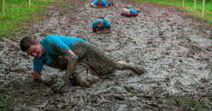 The blue team is going across the mud pool very slowly Stock Footage