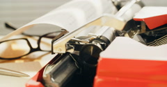 Closeup shot of a typewriter in use in a sunny office. - stock footage