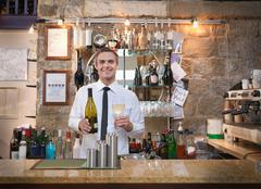 Host offering wine in restaurant - stock photo