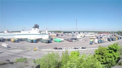 HANKO, UUSIMAA, FINLAND, MAY 30 Time lapse of people working and trucks drivi Stock Footage