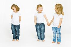Two girls holding hands, third upset Stock Photos