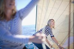 Women adjusting sails on boat Stock Photos