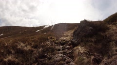 Bright Sun Illuminates Withered Grass on Mountain Top Stock Footage