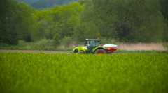 Tractors sprayed with fertilizer Stock Footage