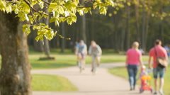 Blurred background of people activities in park. - stock footage