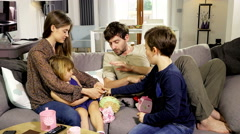 Happy family playing on sofa at home Stock Footage