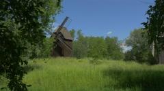 Woman Walks Near Old Windmills Stock Footage