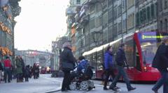 Indifferent people walking by disabled person, nobody helps woman in wheelchair Stock Footage
