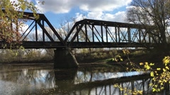 Beautiful Fall Shot train crossing historic bridge Ft Wayne Indiana Stock Footage