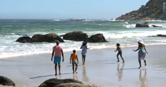 4K Happy family having fun together on beautiful South African beach Stock Footage