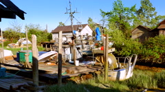 4K Pier at Low Tide, Fishing Village Community, Tall Wetland Grasses Stock Footage
