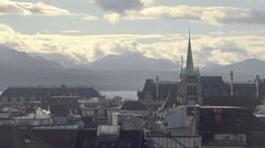 Gothic spire of Saint Francois Church, misty cityscape of Lausanne, Switzerland Stock Footage