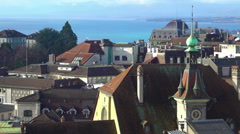 Beautiful view of blue Lake Geneva, red roofs and Gothic spires in Lausanne Stock Footage