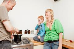 Parents cooking for reluctant son Stock Photos
