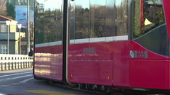 Environmentally safe streetcar carrying passengers in city, ecology problem Stock Footage