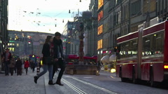 Modern environmentally friendly public transport moving in crowded city street Stock Footage