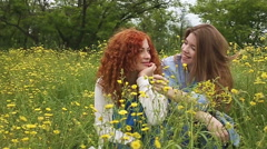 Girl pinches nose to her girlfriend. Slow motion - stock footage
