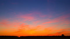 4k timelapse of late evening orange sky with cirrus clouds. After sunset sky - stock footage
