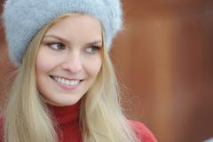 Woman wearing furry hat outdoors Stock Photos