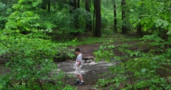 Kid Playing Outside in the Woods 4k Stock Video Stock Footage