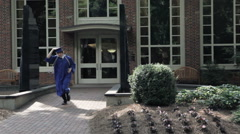 High School Grad Dressed In Cap and Gown Stock Footage